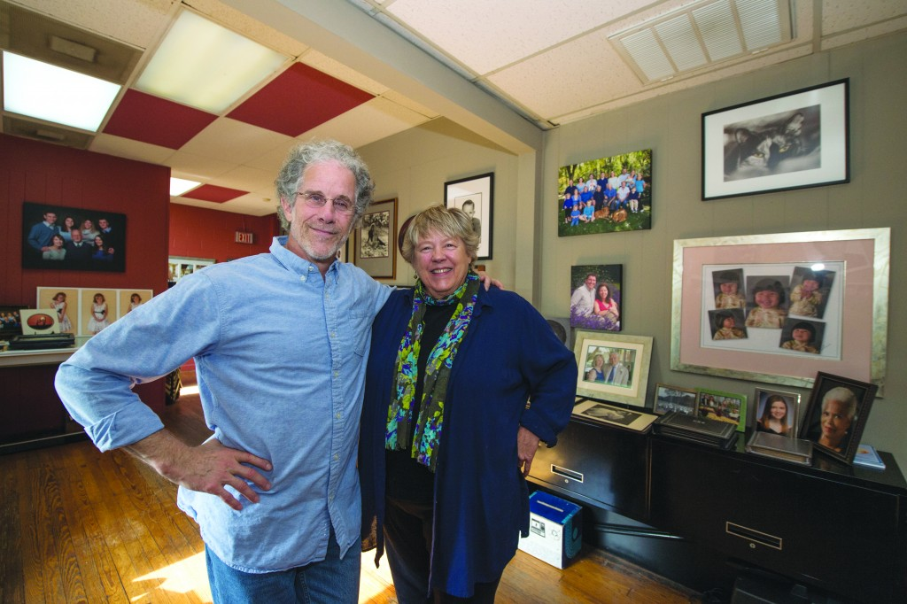 UNITED STATES - November 16. 2015: Neil Steinberg and K.D. Kidder of Photoworks pose for a photo in their studio in downtown Leesburg Virginia. The photo was taken for a feature story on the longest lasting businesses in downtown, Leesburg Vitner, Robinson's Barber Shop, and PhotoWorks. (Photo By Douglas Graham/Loudoun Now)
