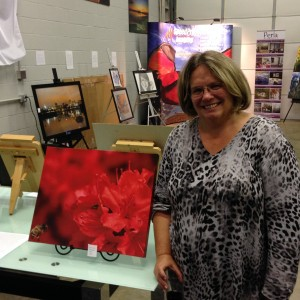 Ashburn's Laurie Proulx shows her vivid flower photograph.