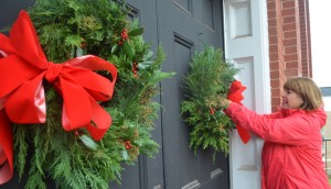 Members of the Leesburg Garden Club spent Tuesday morning making and hanging holiday wreaths.