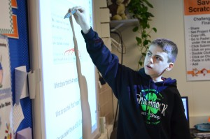 Seventh-grader Julian Frattarola translates Python computer code for his classmates in Blue Ridge Middle School's pilot coding program.
