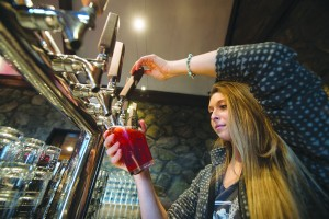UNITED STATES - December 7, 2015: Jessie Puffberger pours a pint at Dirt Farm Brewing. Nested in Blue Ridge Mountains 1 mile outside of the village of Bluemont, the family owned and operated farm sits on 100 acres in Loudoun County. The brewery has spectacular easterly views of the Loudoun Valley and also a nice rustic tasting room that was built in the 1940's and has plenty of indoor and outdoor seating. Dirt Farm's focus is brewing small batches of hand crafted beer from fresh ingredients grown on the family farm.  (Photo By Douglas Graham/Loudoun Now)