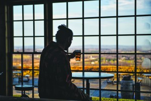 UNITED STATES - December 7, 2015: Daniel Roca-Zela enjoys a pint at Dirt Farm Brewing. Nested in Blue Ridge Mountains 1 mile outside of the village of Bluemont, the family owned and operated farm sits on 100 acres in Loudoun County. The brewery has spectacular easterly views of the Loudoun Valley and also includes a rustic tasting room that was built in the 1940's and has plenty of indoor and outdoor seating. Dirt Farm's focus is brewing small batches of hand crafted beer from fresh ingredients grown on the family farm.  (Photo By Douglas Graham/Loudoun Now)