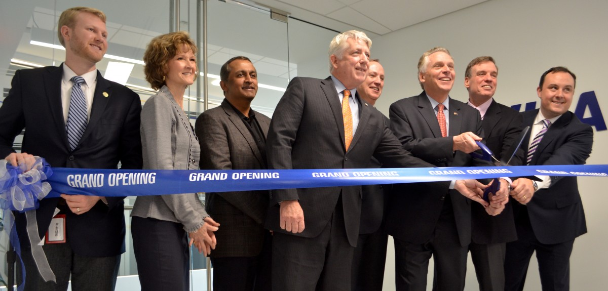 Dignitaries, including Virginia Attorney General Mark Herring (D), Gov. Terry McAuliffe (D) and U.S. Sen. Mark Warner (D-VA), cut the ribbon to formally open the new Visa Cyber Fusion Center. (Danielle Nadler/Loudoun Now)