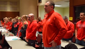 Students and parents dressed in red during the Loudoun Board of Supervisors' Feb. 27 budget public hearing as part of their effort to win funding to install artificial turf fields at the campus.