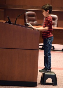 Kade Zisko addresses the Loudoun Board of Supervisors during its Feb. 27 budget public hearing. He joined his brother and mother in urging supervisors to support funding for library programs.