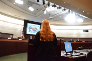 Dominion High School student athlete Camryn Mills, older sister of Cathryn Mills, faces the Board of Supervisors. Renss Greene/Loudoun Now
