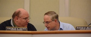 Councilmen Dave Butler (right) and Tom Dunn confer during a special meeting to elect Leesburg's new mayor.