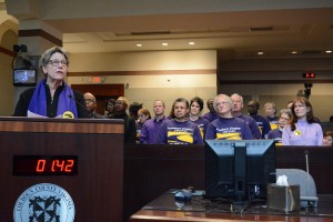Patty Nelson, backed by other Service Employees International Union members, asks the Board of Supervisors to protect county staff pay and benefits. Renss Greene/Loudoun Now
