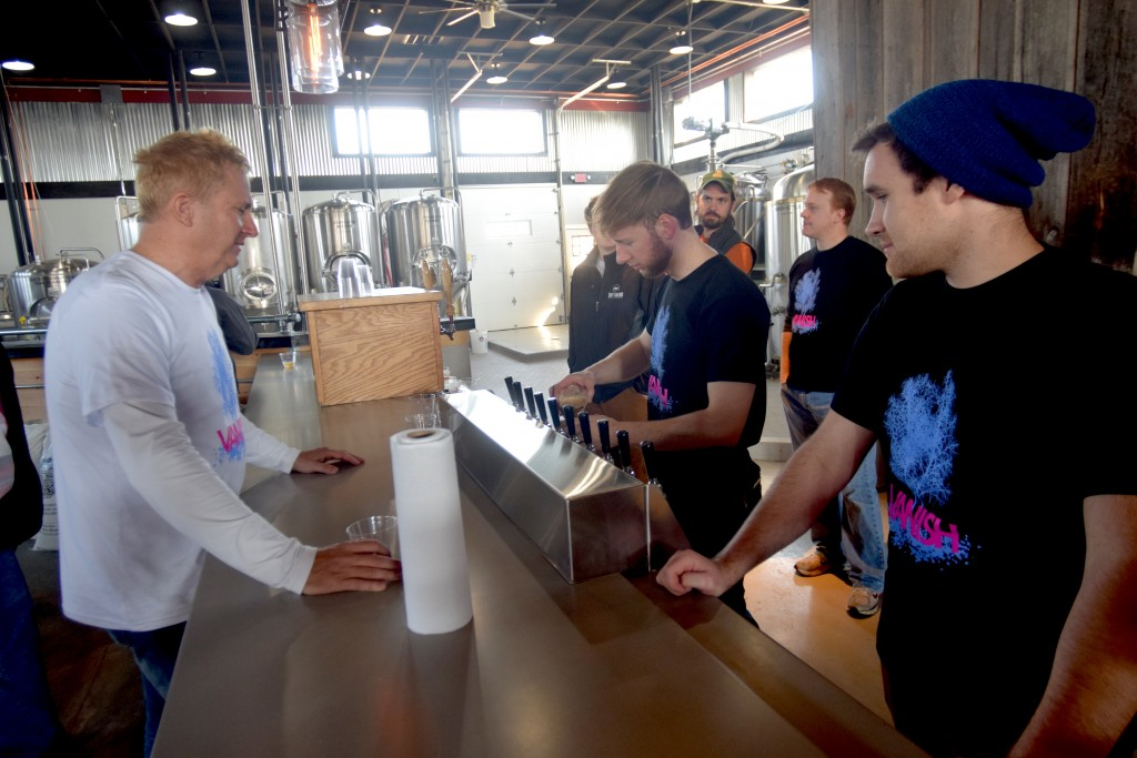 Black Hops Farm's Jonathan Staples, left, at the bar in the Vanish tasting room. (Loudoun Now)