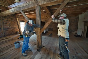 Mike Shockey and Joe Reidel place a timber support beam in a old bank barn thats being restored north of Hamilton by Cochran's Stone Masonry & Timberframing of Lincoln. (Photo by Douglas Graham/Loudoun Now)