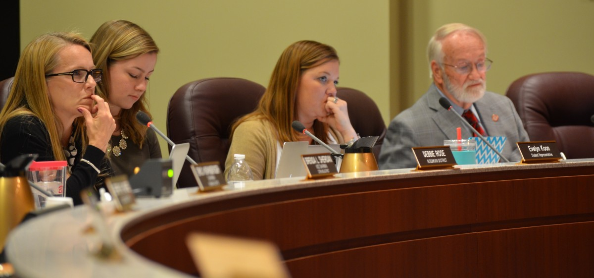 From left- School Board members Debbie Rose (Algonkian), a student board member, Beth Huck (At Large) and Tom Marshall (Leesburg) listen to public speakers ahead of their vote. (Danielle Nadler/Loudoun Now)