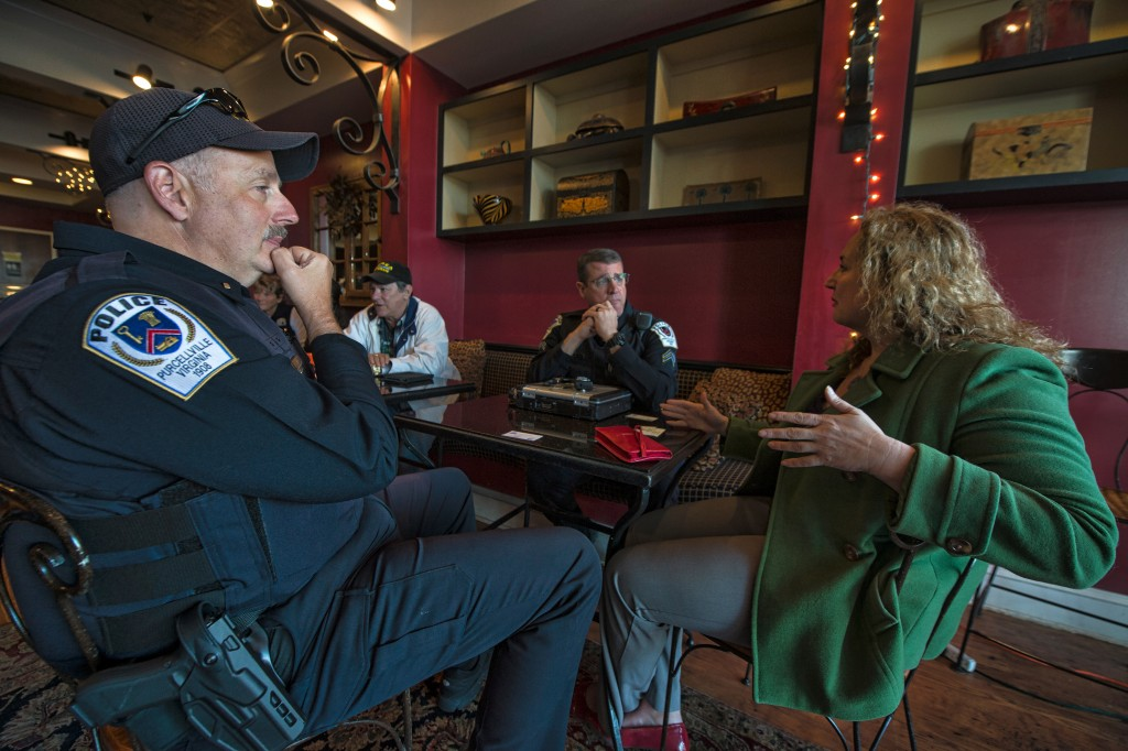 "Purcellville Police Lt. Schroeck and Cpl. Kakol listen to Jennifer Lassiter during ""Coffee with a Cop"" program at Market Street Coffee. (Photo by Douglas Graham/Loudoun Now)"