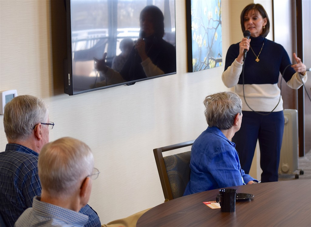 LuAnn Bennett, a Democrat running in Virginia's 10th Congressional District, speaks with residents of Ashby Ponds.