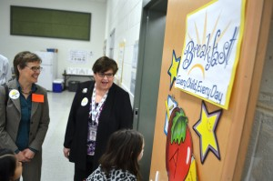 USDA's Food, Nutrition and Consumer Services' Deputy Undersecretary Katie Wilson and Loudoun County School Nutrition Services Supervisor Becky Bays greet students Thursday morning. (Danielle Nadler/Loudoun Now)