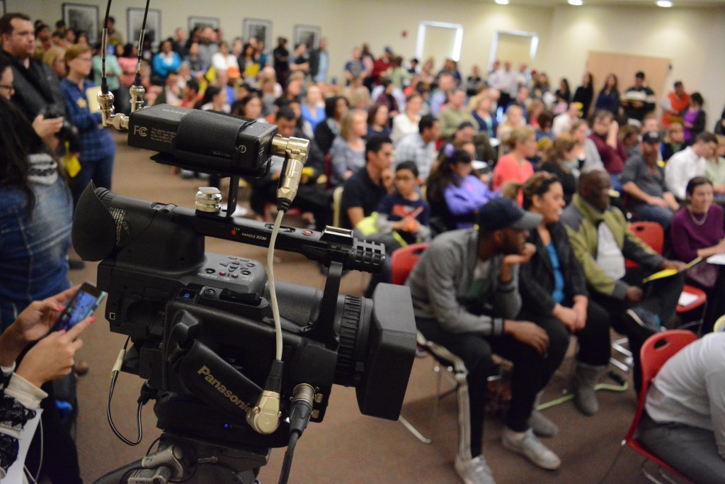 A Univision camera captured the packed Educate Don't Segregate meeting. (Renss Greene/Loudoun Now)