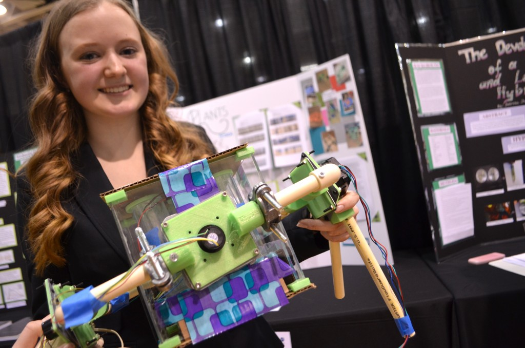 Rock Ridge High School sophomore Gwyneth Schloer shows off her microgravity simulator, where she tested how to provide plants in a zero-gravity environment with enough light using little energy. (Danielle Nadler/Loudoun Now)