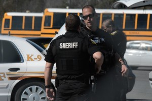 Loudoun County Sheriff's Office deputies search the scene Wednesday morning. (Renss Greene/Loudoun Now)